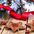 Stock Photo: Gingerbread cookies and Christmas decoration over wooden table