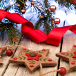 Gingerbread cookies and Christmas decoration over wooden table — Stock Photo