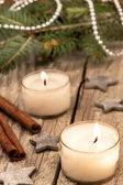 Christmas candles over a old wood background — Stok fotoğraf