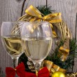 Two champagne glasses and christmas ornaments — Stock Photo