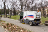 Truck Collecting Fall Leaves in park — Stock Photo
