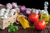 Pasta ingredients on black background — Stock Photo