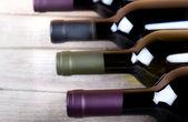 Wine bottles on old wood — Stock Photo