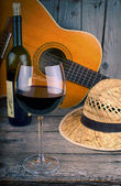 Guitar and Wine on a wooden table — Foto de Stock