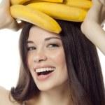Постер, плакат: Smiling woman with bananas
