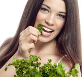 Smiling woman with parsley — Stock Photo