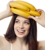 Smiling woman with bananas — Stock Photo