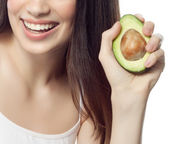 Smiling woman with with avocado — Stock Photo