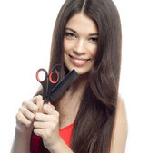 Woman with comb and scissors — Stock Photo