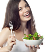 Smiling woman is eating salat — Stock Photo