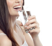 Smiling woman with glass of water — Stock Photo