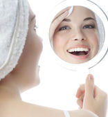 Woman is cleaning her face by cotton disc — Stock Photo