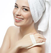 Smiling woman with towel on head — Stock Photo
