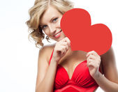 Woman in red dress with heart — Stockfoto