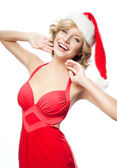 Woman in santa's hat — Stock Photo