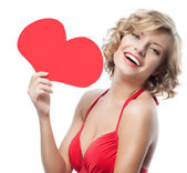 Woman in red dress with heart — Stock Photo