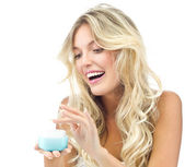 Smiling woman with cream — Stock Photo