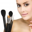 Woman with make up brushes — Stock Photo #39084485