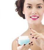 Woman is applying cream — Stock Photo