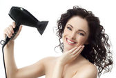 Woman brunette with hairdryer — Stock Photo