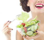 Woman is eating salat — Stockfoto