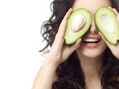 Woman with avocado — Stock Photo