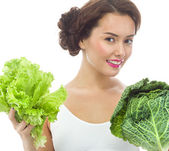 Woman with salad and cabbage — Stock Photo