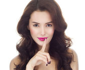 Woman with finger on her lips gesturing shh — Stock Photo