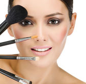 Woman with make up brushes — Stock Photo