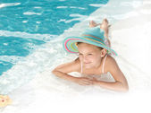 Girl in the swimming pool — Stock Photo