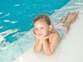 Girl in the swimming pool — Stock Photo