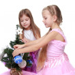 Stock Photo: Two girls decorating Christmas tree