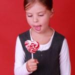Little schoolgirl with lollipop — Stock Photo