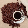 Cup of coffee with roasted coffee-beans - Stock Photo