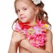 Nice little girl in fancy dress of pink flowers and skirt made of straw — Stock Photo #17843199