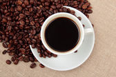 Cup of coffee with roasted coffee-beans — Stock Photo