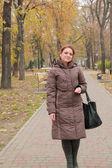 Beautiful woman walking in the park — Stock Photo