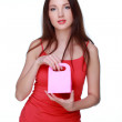 Happy girl with pink gift — Stock Photo