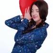 Picture of happy and smiling woman with heart-shaped pillow — Stock Photo #19880683