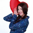 Stock Photo: Picture of happy and smiling woman with heart-shaped pillow