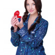 Beautiful girl in pajamas considering a gift  — Stock Photo