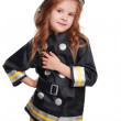 Happy girl firefighter — Stock Photo