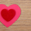 Heart symbol on a wooden background — Stock Photo