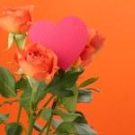 Romantic roses with heart symbol — Stock Photo #21534069