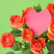 Lovely blossom roses with heart symbol — Stockfoto