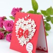 图库照片: Lovely heart shape with floral ornament greeting card