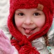 Stock Photo: Pretty girl in a red knitted cap