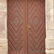 Old wooden door in wall — Foto Stock #21535963