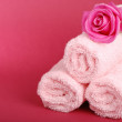 Beautiful pink rose with pink towels for greeting card — Stock Photo
