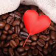 Royalty-Free Stock Photo: Dark brown coffee beans with red heart on Holiday